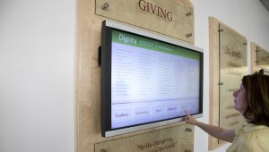 Interactive Digital Donor Wall - This Donor wall combines digital touchscreen with a static wall. Using one screen keeps this wall budget friendly while sharing more donor information.