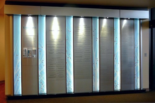 Modular Donor Walls - Karmonos Eye Institute: Accumulative Donor Wall. This wall includes a series of vertical sections filled with a changeable insert system that allows easy updating.