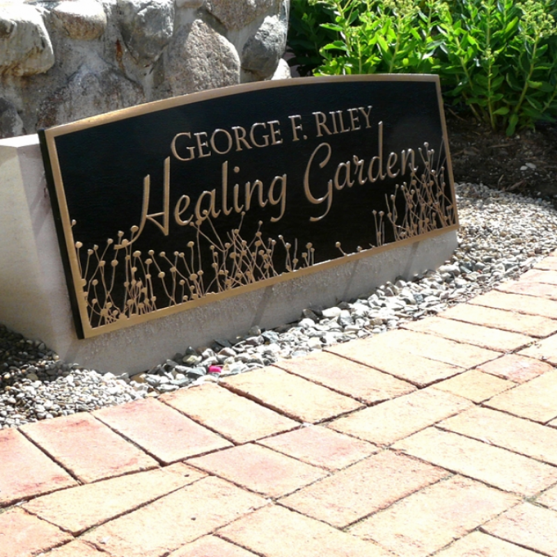 Bronze Garden Plaque - Healing Garden Recognition: This is a large cast bronze plaque attached to a limestone base. The graphics include the floral pattern used on all Cancer Center recognition.